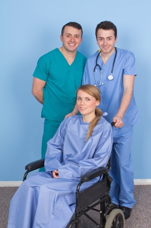 Two medical staff with a patient in a wheelchair photo