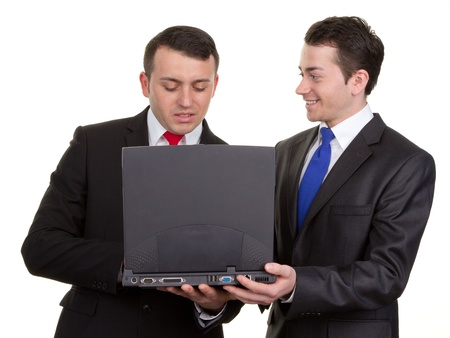 One businessman working with another helping him to use a computer. photo