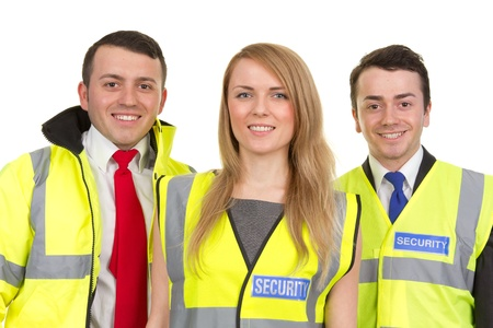 trio: A trio of security guards wearing uniform, isolated on white