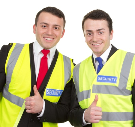 Two security guards standing together showing thumbs up sign, isolated on white photo