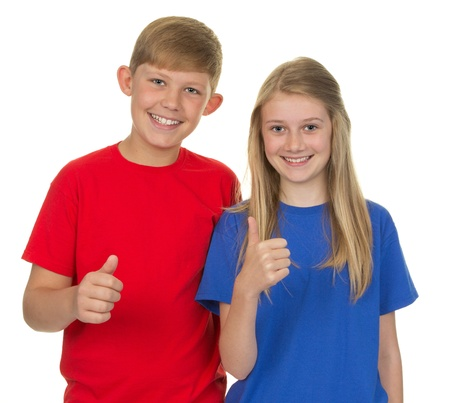 Two children smiling and together, isolated on white photo