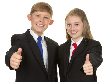 A boy and girl in uniform with a thumbs up sign, isolated on white Stock Photo - 14873896