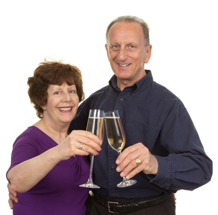 Elderly couple with champagne glasses celebrating, isolated on white photo