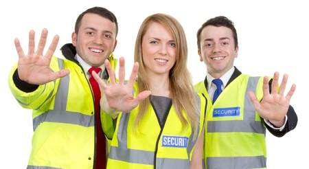 hand guards: Security guard team working together with a stop gesture, isolated on white