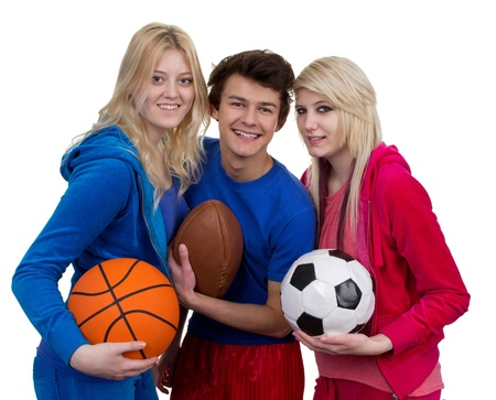 Three teenagers holding different sports balls, isolated on white