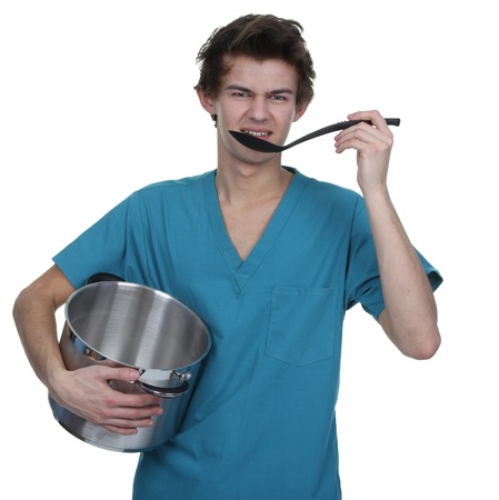 Medical staff holding a sauce pan and a spoon Stock Photo