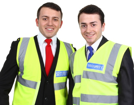 Two security guards standing next to each other, isolated on white Stock Photo