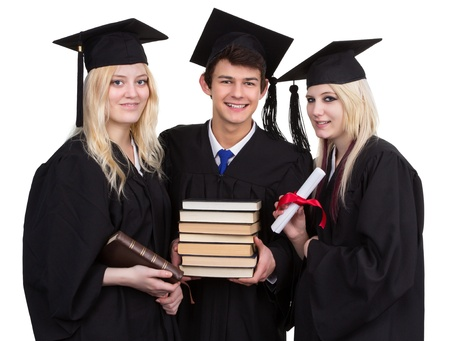 three graduates smiling holding books, isolated on white. photo
