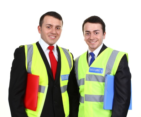 Two security guards, each carrying a folder, isolated on white.