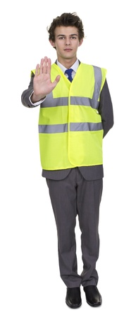 Businessman Wearing Security Jacket Showing Stop Sign Isolated Over White Background photo