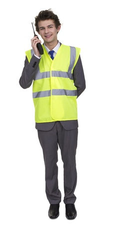 walkie talkie: Man Wearing Security Jacket Talking On Walkie Talkie Isolated Over White Background