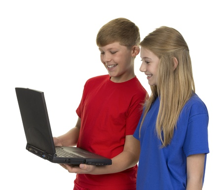 Portrait Of Boy And Girl Looking At Laptop Isolated Over White Background photo