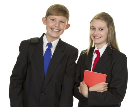 Schoolgirl And Schoolboy Holding Book Isolated Over White Background photo