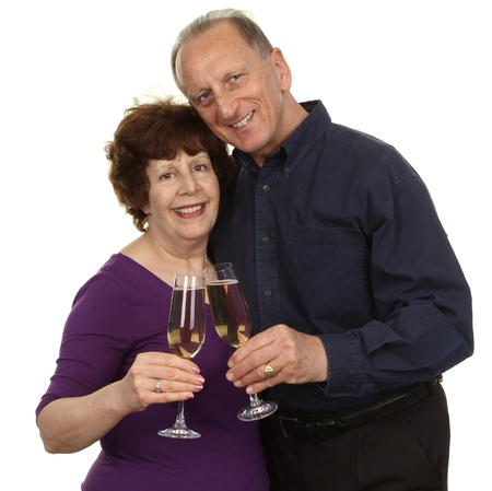 Senior Couple Toasting Champagne Glass Over White Background photo