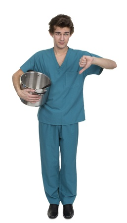 Portrait Of Male Nurse Showing Thumb Down Over White Background Stock Photo