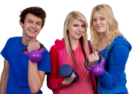 A group of three friends working out using weights, isolated on white. photo
