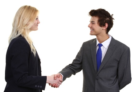 Two business people a man and a woman meeting with a handshake, isolated on white