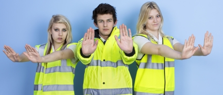 rejecting: Serious Man And Woman Wearing High-visibility Jacket Showing Stop Sign Stock Photo