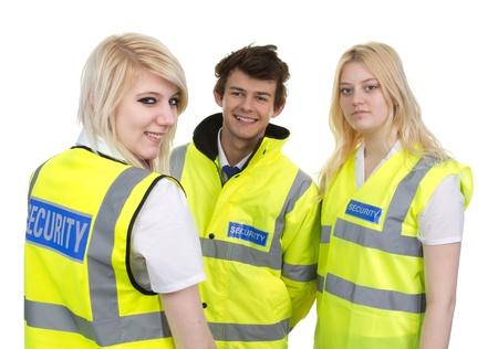 seguridad en el trabajo: Hombre y mujer con chaqueta de alta visibilidad aislados sobre fondo blanco Foto de archivo
