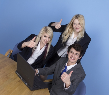 Businessman And Businesswoman Showing Thumb Up In Office photo
