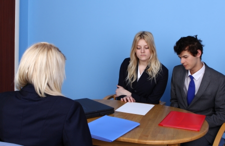 Businesswoman  Showing A Paper To A Businessman In Office photo