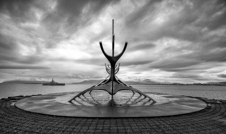 voyager: REYKJAVIK, ICELAND - June 10 2016: Solfar or Sun Voyager in black and white monument in Reykjavik, Iceland. The sculpture was designed by Jon Gunnar Arnason in 1971. Editorial