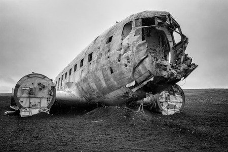 Black and white picture of the crashed   airplane at the beach or at Sandur Iceland