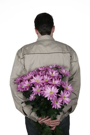 Man holding bouquet of flowers on his back as a surprise Stock Photo - 831351