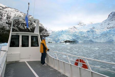 tourist taking a look at big glacier in patagonia, argentina Stock Photo