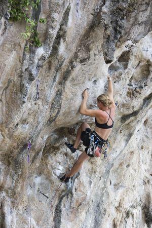 Woman climbing on limestone rock in thailand Stock Photo - 3084475