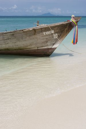 Longtail boat in bright blue water, Koh Poda, Krabi Province, Thailand Stock Photo - 3098405