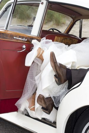bride and groom having fun in the car Stock Photo
