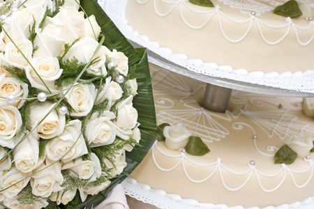 bridal bouquet and wedding cake Stock Photo