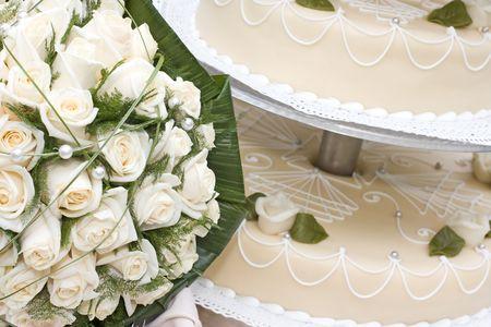 bridal bouquet and wedding cake Stock Photo