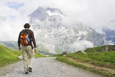 Young man hiking in Swiss Mountains, Switzerland, Jungfrau region