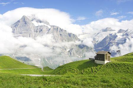 Swiss Mountains. Jungfrau covered in clouds, Jungfrau region, Switzerland Stock Photo