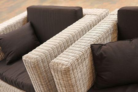 close-up of garden furniture, sofa with black pillows