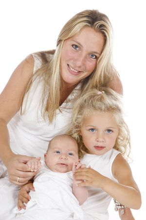 mother with her two daughters all dressed in white