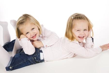 two cute twin sisters having fun
