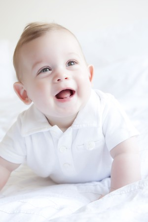 Cute little baby laughing, six months old