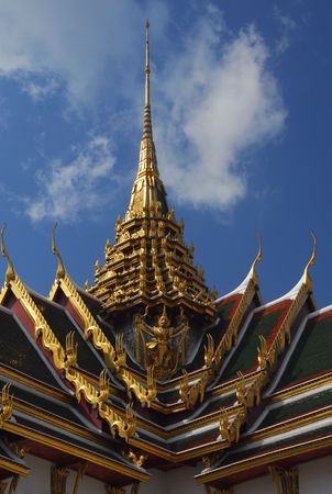 A Garuda, ancient budhis mythical creture on the roof at the Grand Palace in Bankok. Stock Photo - 7392472