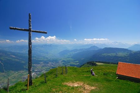 A wooden cross in the Swiss Alps Stock Photo - 7392618