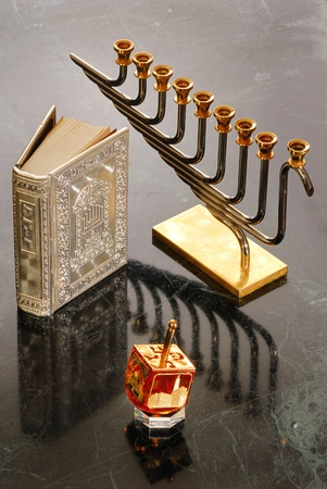 A hanukiah, dreidel and prayer book for Hanukkah Stock Photo