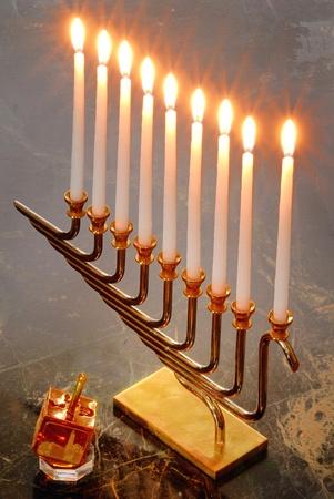 dreidel: A Hanukiah and a dreidel for the Jewish holiday of Hanukkah Stock Photo