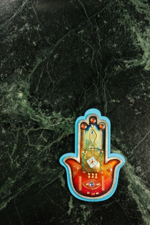 A Hamsa on a universe backround Stock Photo