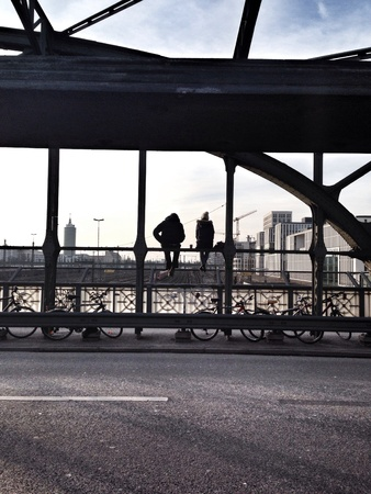 Two people sitting at the bridge