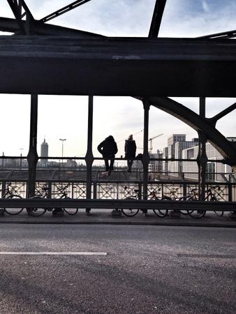 wish: Two people sitting at the bridge