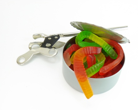 Opening a can of worms: an opened can of red, green and yellow worms with a can opener, on a white background