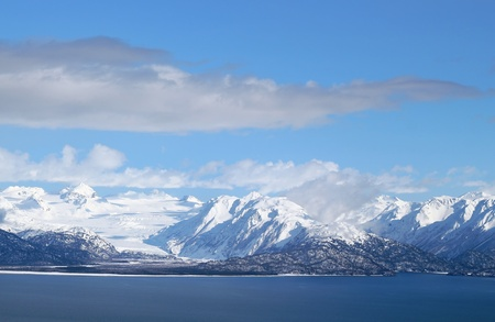 homer: A glacier covered with snow in the Kenai mountains across from Homer Alaska Stock Photo