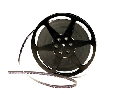 An old film reel with film on a white background